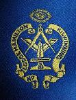 embroidered lodge crest on tie